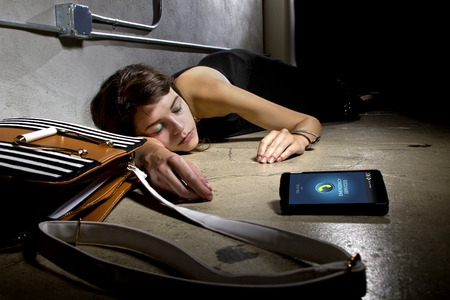blacked: female victim or with medical emergency calling for help with cell phone Stock Photo