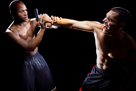 martial artist: Martial artist disarming a criminal with a gun or close quarter combat