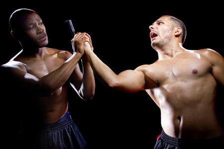 neutralize: Martial artist disarming a criminal with a gun or close quarter combat