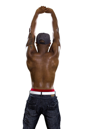 hip hop style: Fit black man in hip hop style clothing flexing back muscles Stock Photo