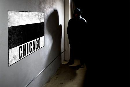 Hooded hip hop rapper next to wall graffiti with copy space Reklamní fotografie - 43687326