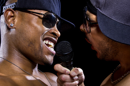 subculture: Hip hop subculture battle between two rappers with microphones Stock Photo