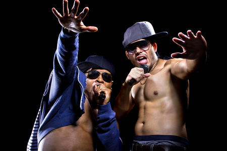 rap music: Hip hop subculture battle between two rappers with microphones Stock Photo