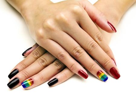 nails: Symbolic LGBTQ pride rainbow nail art manicure on females holding hands Stock Photo