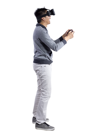 immersed: Male immersed in interactive virtual reality video game doing gestures on white background Stock Photo