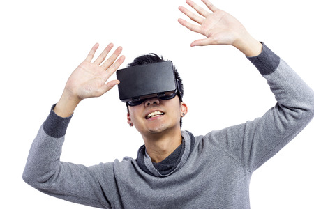 playing video games: Man wearing virtual reality goggles watching movies or playing video games