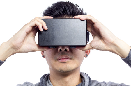 virtual reality simulator: Man wearing virtual reality goggles watching movies or playing video games