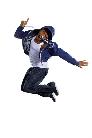 tanzen: Black urban break dancer wearing a blue hoodie and jumping Lizenzfreie Bilder
