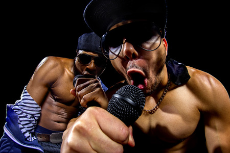 hip hop man: Rappers having a hip hop music concert with microphones Stock Photo