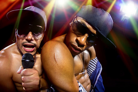 hip hop: Rappers having a hip hop music concert with microphones Stock Photo