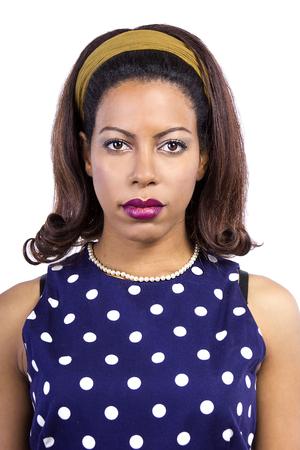 polka dot dress: Black female wearing a blue vintage polka dot dress on a white background