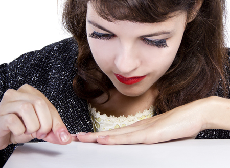 Retro style woman pretending to pick something up from surface for composites