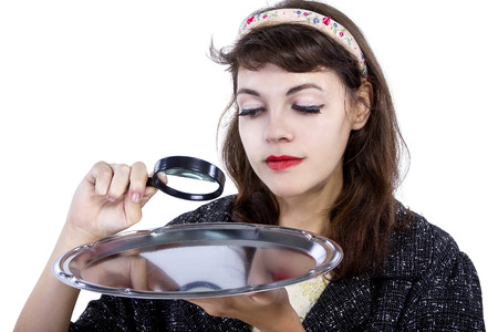 meticulous: Retro style woman looking for something with a magnifying glass for composites