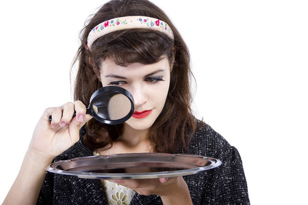 Retro style woman looking for something with a magnifying glass for composites