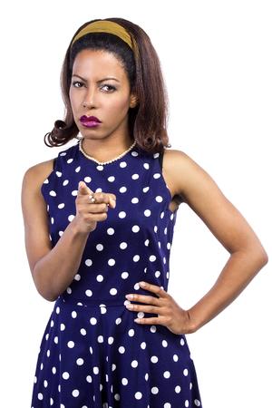 Angry black female wearing retro fashion style polka dot dress Stockfoto