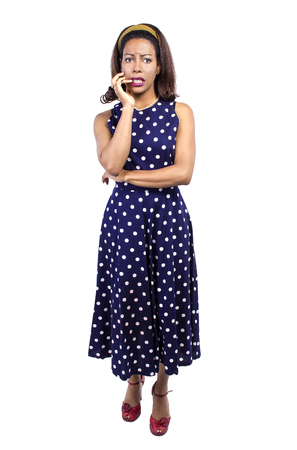 polka dot dress: Depressed black female wearing retro fashion style polka dot dress Stock Photo
