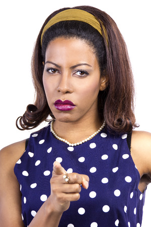 disapprove: Angry black female wearing retro fashion style polka dot dress Stock Photo