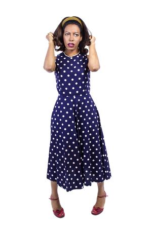 Anxious black female wearing retro fashion style polka dot dress Reklamní fotografie