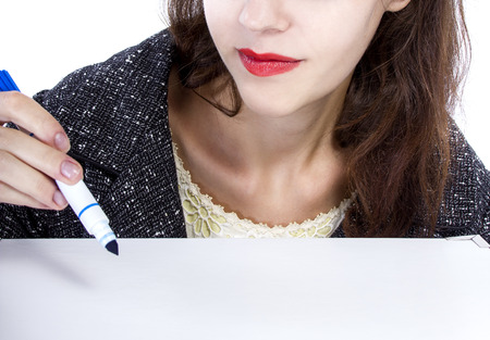 pen and marker: Creative female using a blue marker to write on a blank surface Stock Photo
