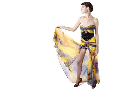 silk tie: Young female wearing a fashionable yellow silk tie dye dress
