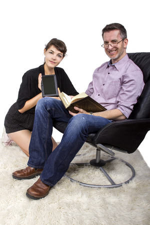 ereader: Father and daughter reading at home on a shag carpet