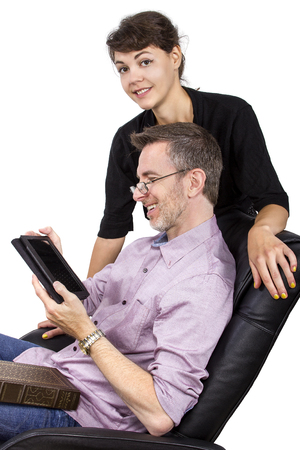 ereader: Young female giving her single father a tablet as a gift Stock Photo