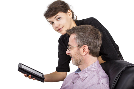 e book device: Young female giving her single father a tablet as a gift Stock Photo