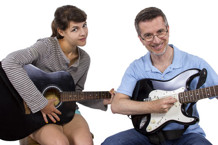 how to: Music student practicing how to play guitar with her teacher