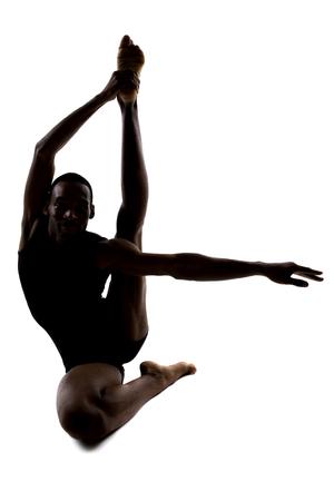 bonhomme blanc: Silhouette d'un m�le posant danseur souple et en �quilibre sur fond blanc