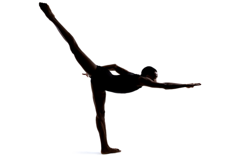 contortionist: Silhouette of a flexible male dancer posing and balancing on white background