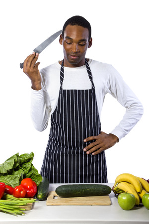 African American male chef wearing an apron cooking isolated on a white background