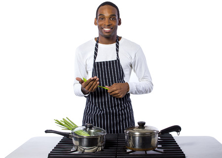 african american man: African American male chef wearing an apron cooking isolated on a white background