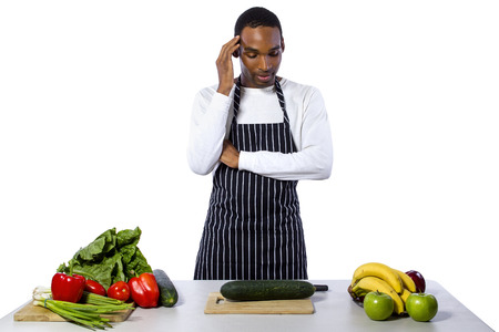 hospitality staff: African American male chef wearing an apron cooking isolated on a white background