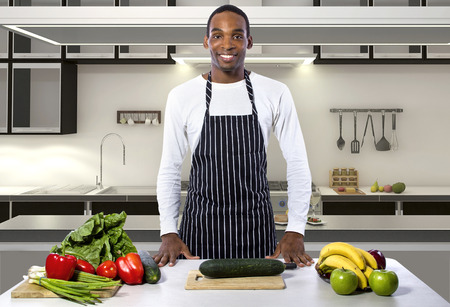 hospitality staff: African American male chef wearing an apron in a home or restaurant kitchen