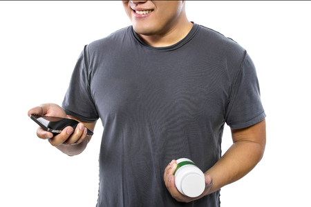 ordering: Man ordering drugs or supplements from an internet pharmacy
