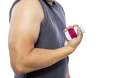 Man showing fat burner supplement results on his biceps