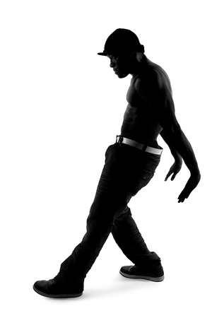 breakdancing: Black and white silhouette of a male dancer posing with dance moves Stock Photo