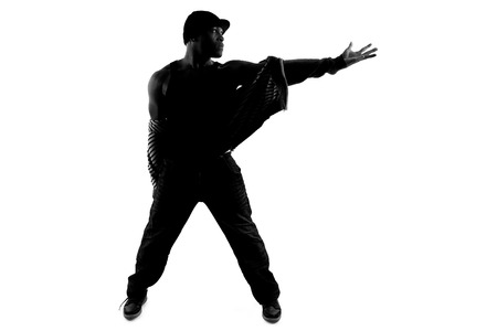 male silhouette: Black and white silhouette of a male dancer posing with dance moves Stock Photo
