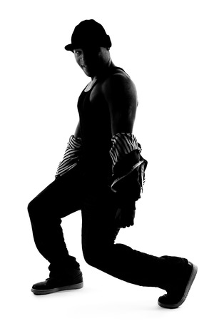 breakdancer: Black and white silhouette of a male dancer posing with dance moves Stock Photo