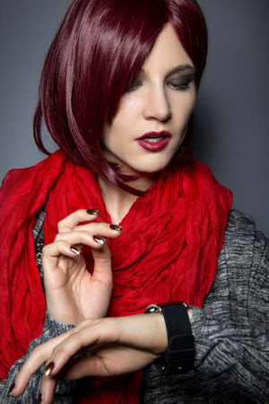 togs: Stylish woman in red wearing an electronic smartwatch wearable tech