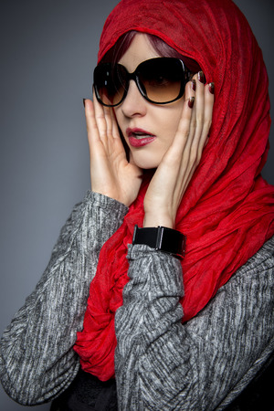 arab glamour: Caucasian or Persian woman modeling modern fashion with head scarf or Hijab
