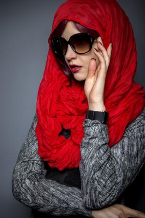 head scarf: Caucasian or Persian woman modeling modern fashion with head scarf or Hijab