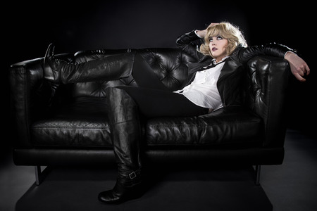 nonconformity: Female wearing black punk rock style leather expressing unique fashion style Stock Photo