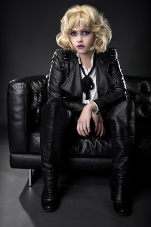 rockstar: Female wearing black punk rock style leather expressing unique fashion style Stock Photo
