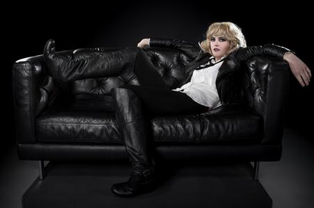 nonconformity: Female wearing black punk rock style leather expressing unique fashion style Stock Photo