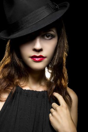 film noir: Actress with classic smoky dark make up in film noir style