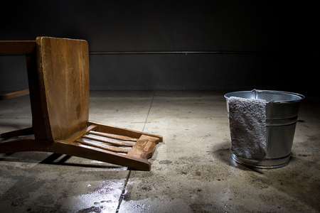 controversial: Torture chamber with a water bucket for controversial waterboarding