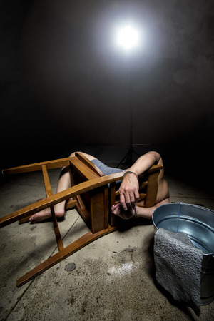 inhumane: Prisoner being punished with cruel interrogation technique of waterboarding