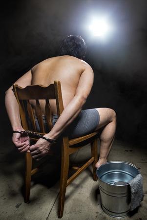 cruel: Prisoner being punished with cruel interrogation technique of waterboarding