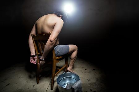 prisoner of war: Prisoner being punished with cruel interrogation technique of waterboarding